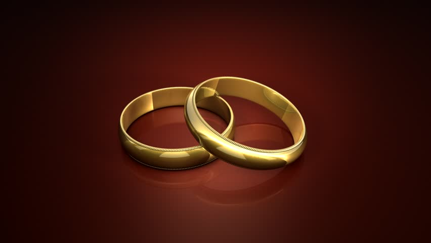Wedding rings on a dark background art. The video clip is made in Cinema 4D (render in 16bit Tiff-sequence). Finishing in After Effects.