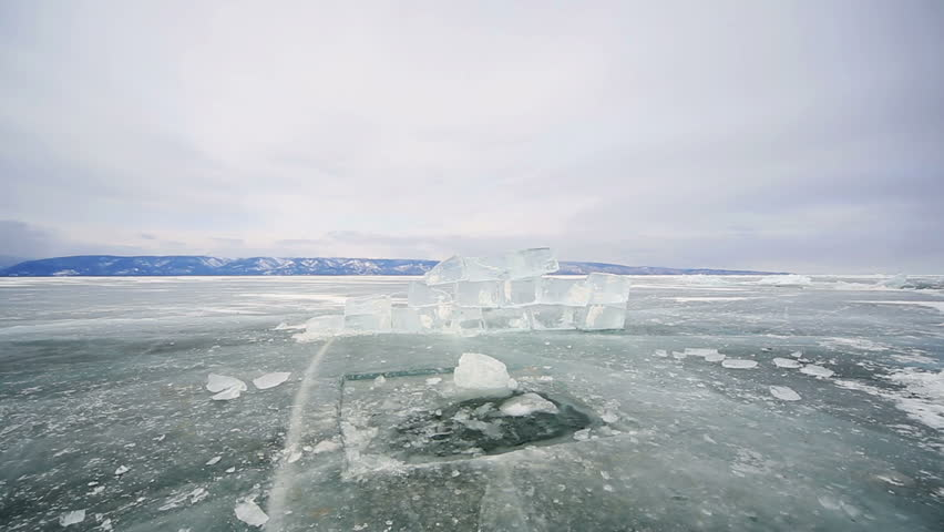 Hole in the ice Baikal ice, icy hole and block | Shutterstock HD Video #9284687