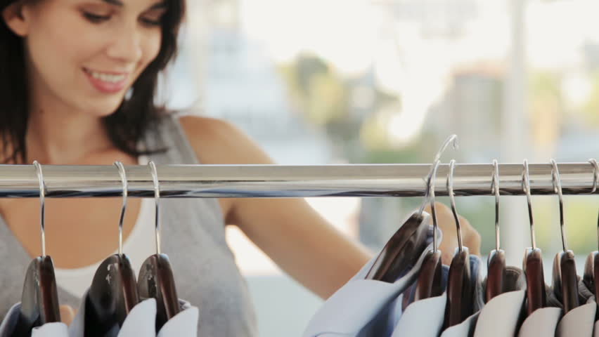 Woman Shopping for Clothing | Shutterstock HD Video #930124