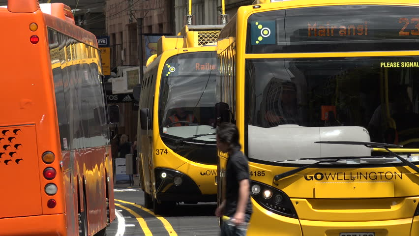 WELLINGTON, NORTH ISLAND/NEW ZEALAND - JANUARY 28, 2015: Unidentified people cross road, Go electric trolley buses. The trolleybus network started between 1949 and 1964 to replace the city trams. | Shutterstock HD Video #9304325