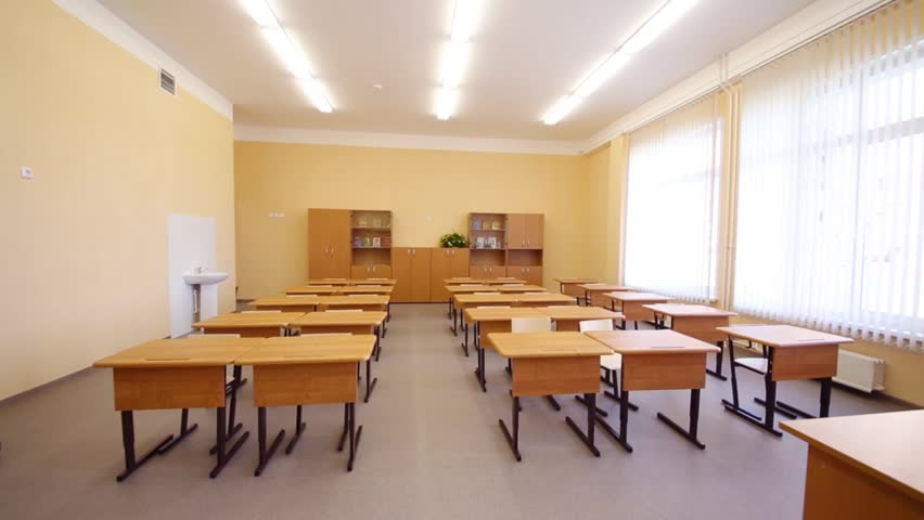Modern White Classroom ~ Empty classroom with wooden desks white and green chalk