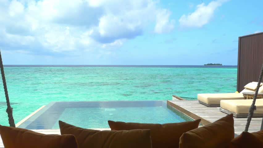 Luxurious ocean villa terrace with private pool and daybeds