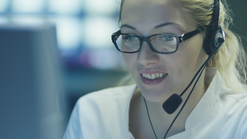 Woman Operator in Customer Support Service Center. Shot on RED Cinema Camera in 4K (UHD). | Shutterstock HD Video #9345047