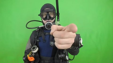 Dive instructor shows sing  YOU  also a available on the green screen all of diving sings from course  with full dive gear (open water diver) all background from movies separately in portfolio13. /13