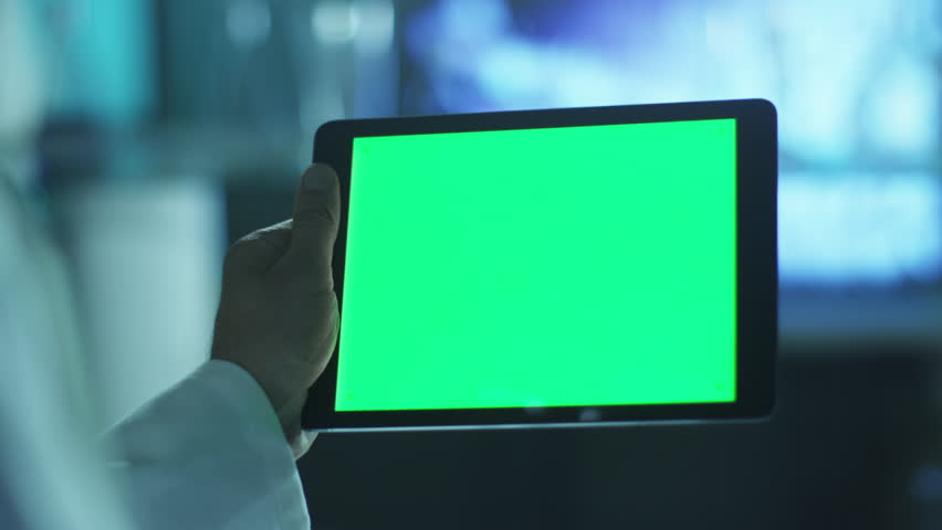 Using Tablet with Green Screen in Landscape Mode. Scientific Environment. Shot on RED Cinema Camera in 4K (UHD). Great for Mock-up usage. | Shutterstock HD Video #9421871