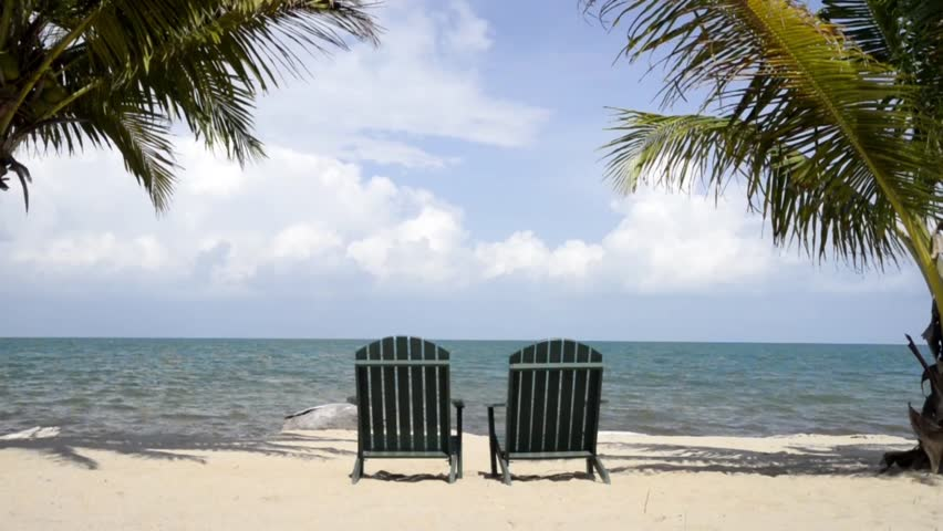 Tracking Dolly Shot Of Two Chairs On Beach Waiting For You Hd Stock Video