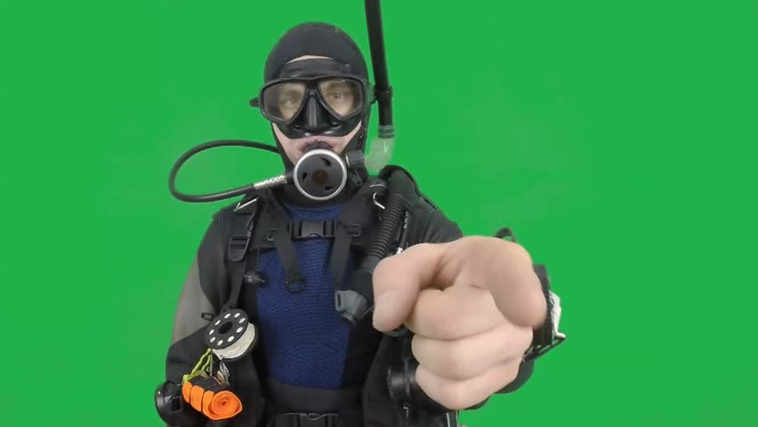 Dive instructor shows sing:LOOK AT MEalso a available on the green screen all of diving sings from course  with full dive gear (open water diver) all background from movies separately in portfolio1/06
