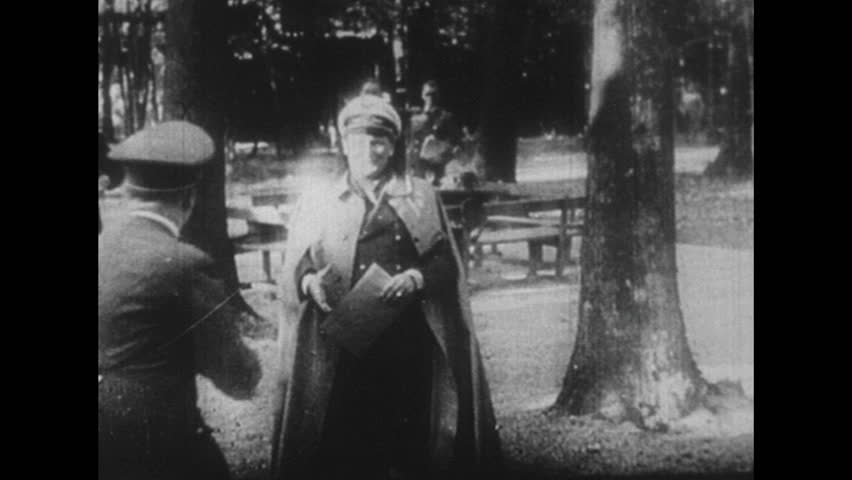 GERMANY 1940s - Adolf Hitler meets with his field marshal Herman Goering in a forest to confide classified information.