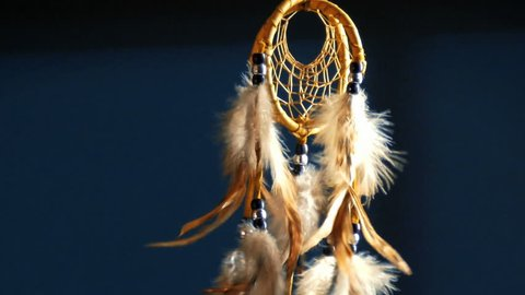 Native American dreamcatcher blowing in breeze at night