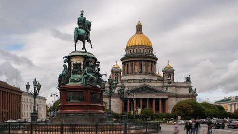 Saint Petersburg, Russia - CIRCA OCTOBER 2014: Golden dome of St. Isaac's Cathedral (1818) and the equestrian statue of Tsar Nicholas (1859), time-lapse
