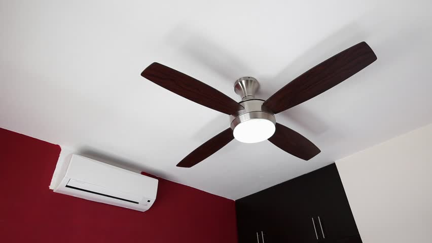 Stock video of electric ceiling fan and wall split system 9536720 hd0028electric ceiling fan and wall split system air conditioner indoors aloadofball Choice Image