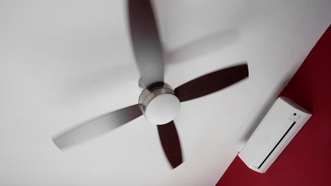 Electric Ceiling Fan And Wall Split System Air Conditioner Indoors