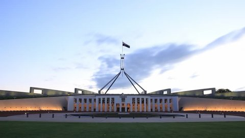 PARLIAMENT HOUSE, CANBERRA - FEBRUARY 2015: Afternoon dusk sunset timelapse of Parliament House, the meeting facility of the Parliament of Australia located in Canberra, the capital of Australia.
