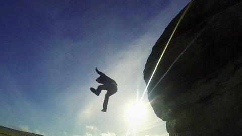 Super Slow Motion - Man Jumps Off Rocks 02