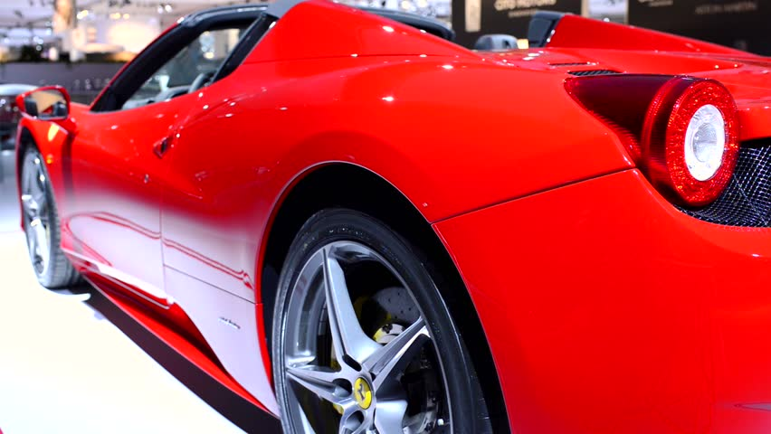 AMSTERDAM, THE NETHERLANDS - APRIL 16, 2015: Ferrari 458 Spider V8 sports car rear view at the 2015 Amsterdam motor show. The Spider is the convertible version of the Ferrari 458 Italia.