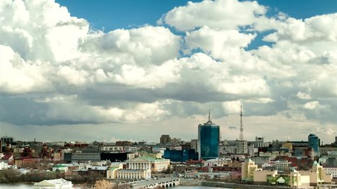 Cloudy day over Chelyabinsk, a city in Russia. many people hurry about their business and above them a great effect of clouds. Time lapse