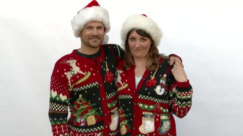 fdc300ba1 Model released man and woman wearing ugly Christmas sweaters in studio