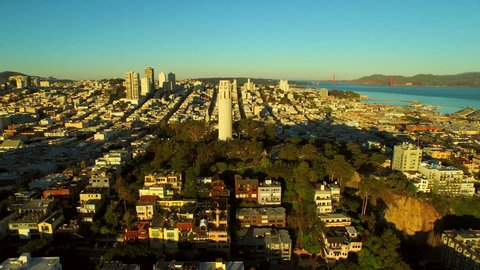 San Francisco Aerial v37 Flying low over Telegraph Hill and close to Coit Tower at sunrise.