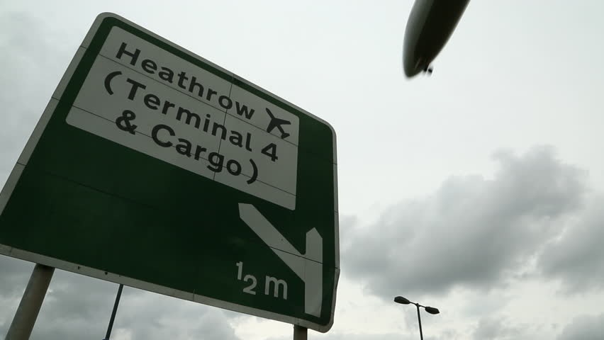 Heathrow Airport Sign with aircraft Flyover