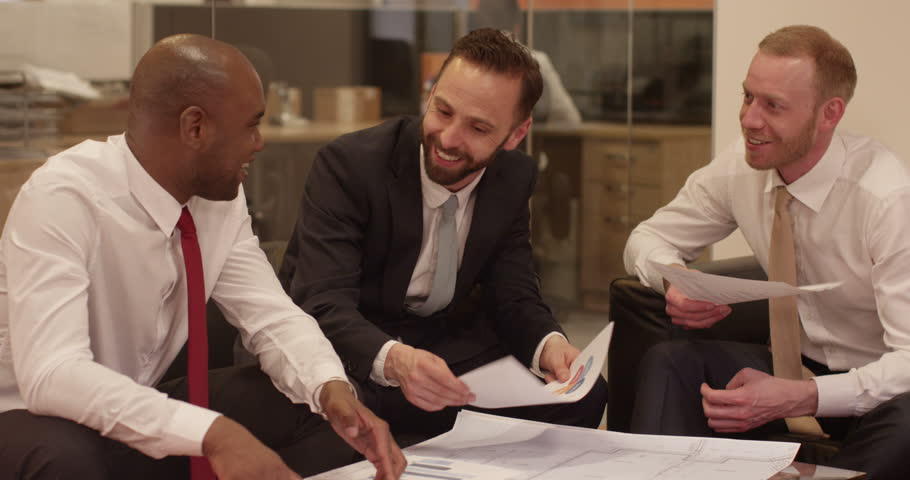 Cheerful business partners at a modern glass office. In slow motion. | Shutterstock HD Video #9680747