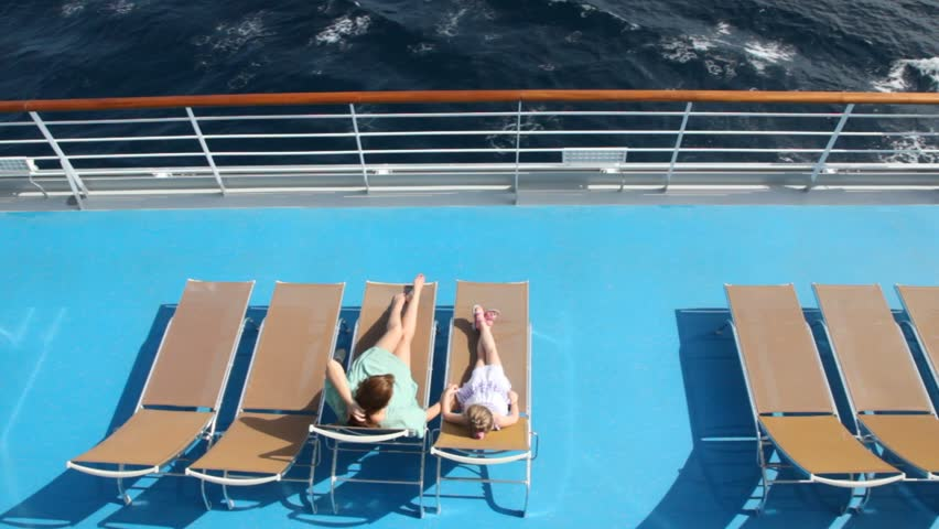woman and girl are lying on the deck chairs on deck of ship