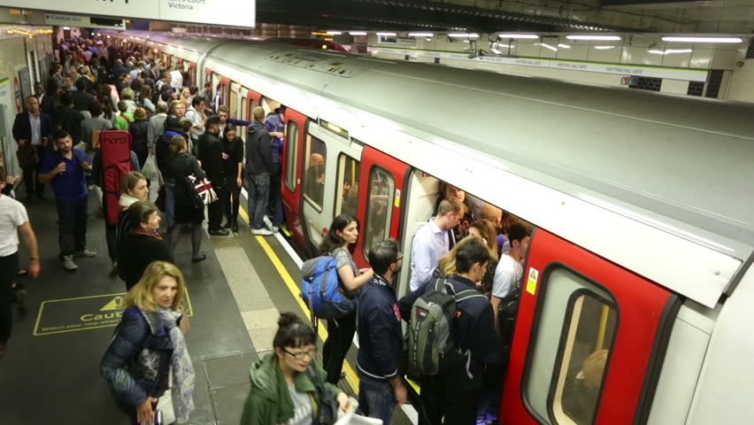 LONDON - CIRCA SEPTEMBER 2014, London underground subway train station time-lapse,  train arrives & unidentified crowds of people move to disembark & embark the train, London September 2014