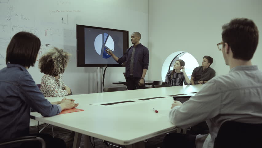 Man explaining pie chart during meeting in conference room | Shutterstock HD Video #9691217