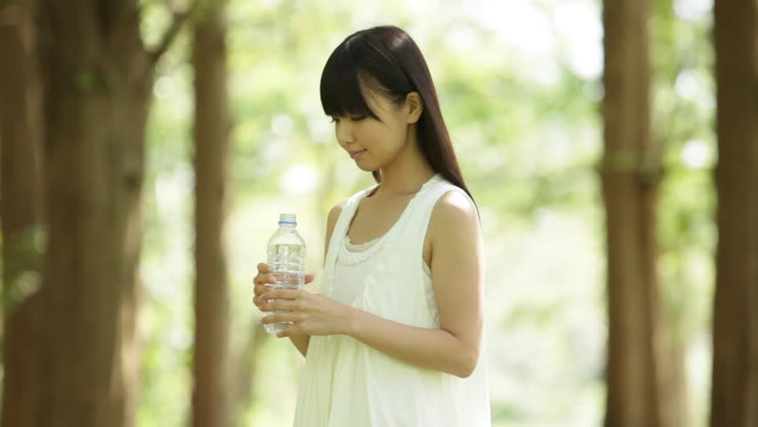 Attractive Young Japanese Girl Drinking Stock Footage Video (100%  Royalty-free) 9709427   Shutterstock