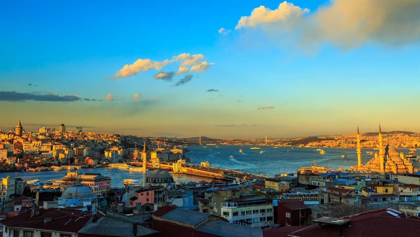 ISTANBUL - APRIL 02: Panoramic view over Istanbul during golden hour with view at the Galata Bridge, Yeni Mosque and Boat Traffic. Time Lapse in 4K. April 02, 2015 in Istanbul, Turkey.    Shutterstock HD Video #9716387