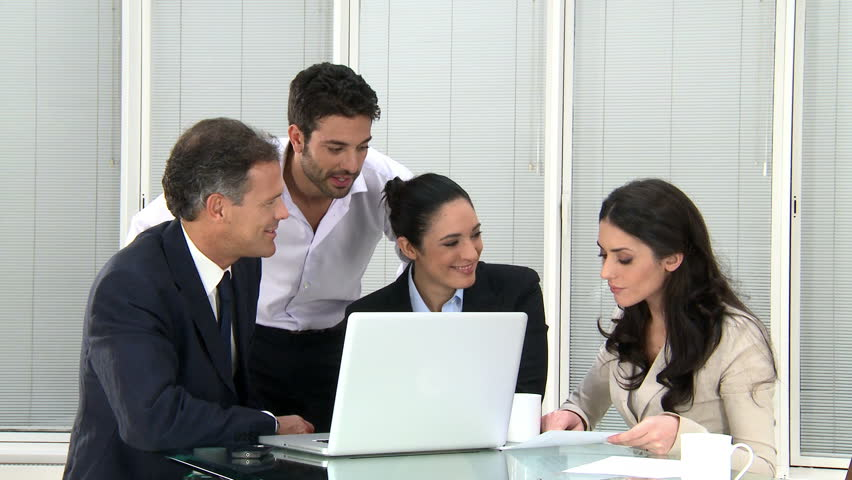 Happy Business Team Discussing And Working Together At Office