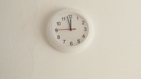 Midday. White clock hanging on wall ticking. Full HD 1920x1080