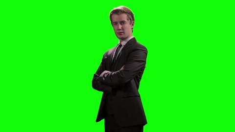 Young executive businessman smiling and confident against greenscreen