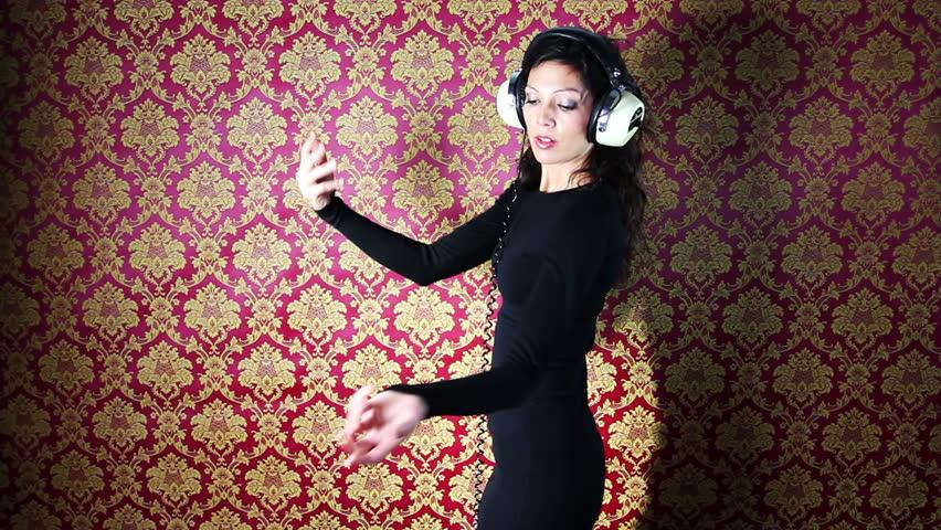 A sexy woman dances against a classic wallpaper print | Shutterstock HD Video #977317