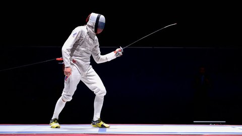 ST. PETERSBURG, RUSSIA - MAY 2, 2015: Dmitry Rigin of Russia vs Vincent Simon of France in the semifinal of International fencing tournament St. Petersburg Foil, the stage of FIE World Cup