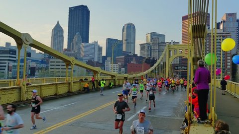 PITTSBURGH, PA - Circa May, 2015 - Participants race across the Andy Warhol Bridge at the 2015 DICK'S Sporting Goods Pittsburgh Marathon.