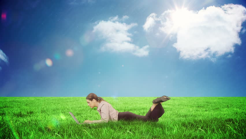 Digital animation of Businesswoman using laptop in a field | Shutterstock HD Video #9911591
