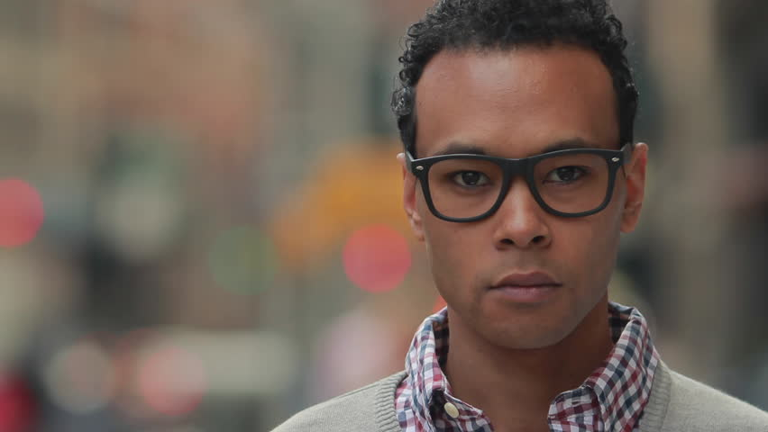 Young African Asian man in city serious face portrait | Shutterstock HD Video #9925517