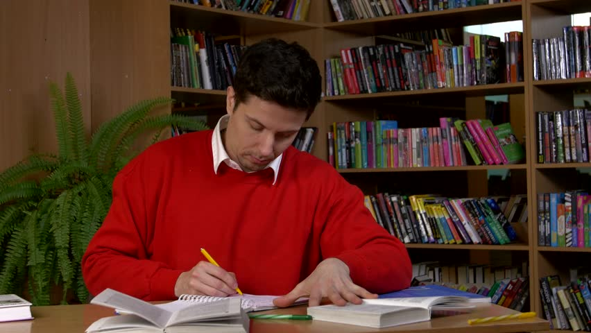 Boy In Red Sweater Researching With A Book In A Library, Outlines ...
