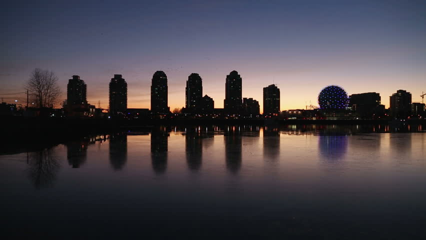 Sunrise twilight view of the Vancouver skyline on the edge of False Creek including condominium towers and the geodesic dome of Science World. British Columbia, Canada. | Shutterstock HD Video #9936704