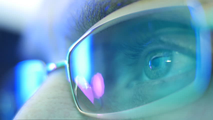 Reflection in the eye and glasses of the monitor screen when watching an action movie. Closeup. Shallow depth of field | Shutterstock HD Video #9940301