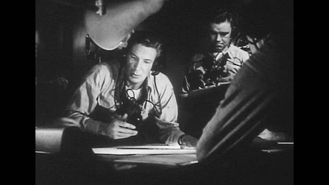 UNITED STATES 1940s: Radar operators with map / Hand marks on map / Operators, man speaks into microphone / Operators with map.