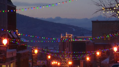Park City, Utah's bustling Main Street with lights and cars at night in winter.