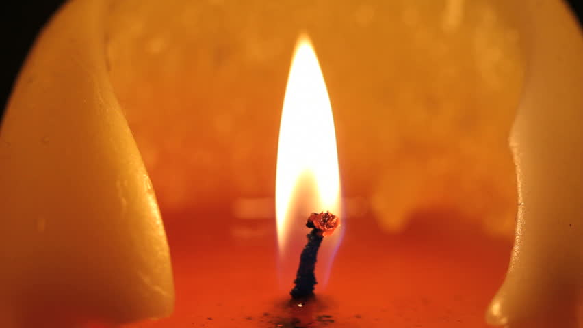 Macro shot of a candle burning and flickering
